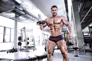Bodybuilder showing off massive legs